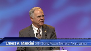 Ernest A. Mancini receives the 2014 Sidney Powers Award