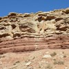 The Impact of Rock Typing & Sandstone Petrology in Exploration & Production